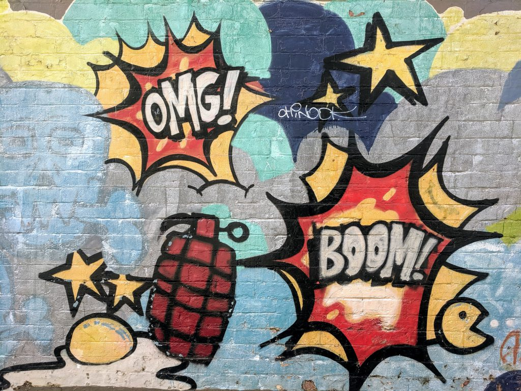 omg! and boom grafitti on wall