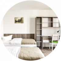 Here you would see a round image of an aparthotel